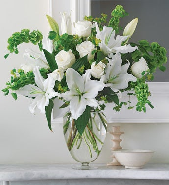 stunning trumpet shaped lilies in ginger jar vase