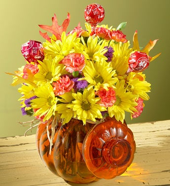 flowers in pumpkin container