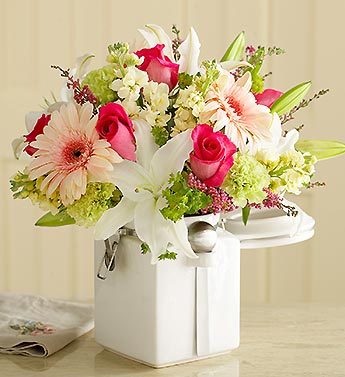 mixed arrangement in white ceramic canister