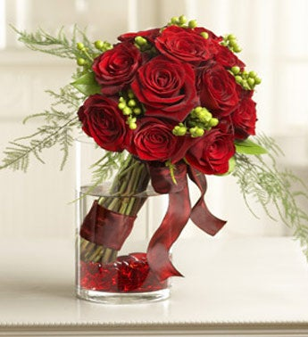 /one dozen red roses in cylinder vase with ribbon