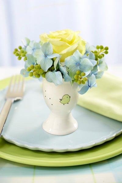 Yellow and Blue Flowers in an Easter Egg Cup
